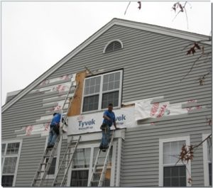 image of add ventures workers replacing siding