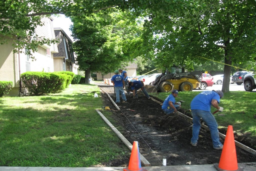 add ventures workers preparing a community living area for construction services