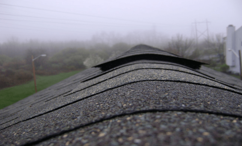 roofing shingle peak of house